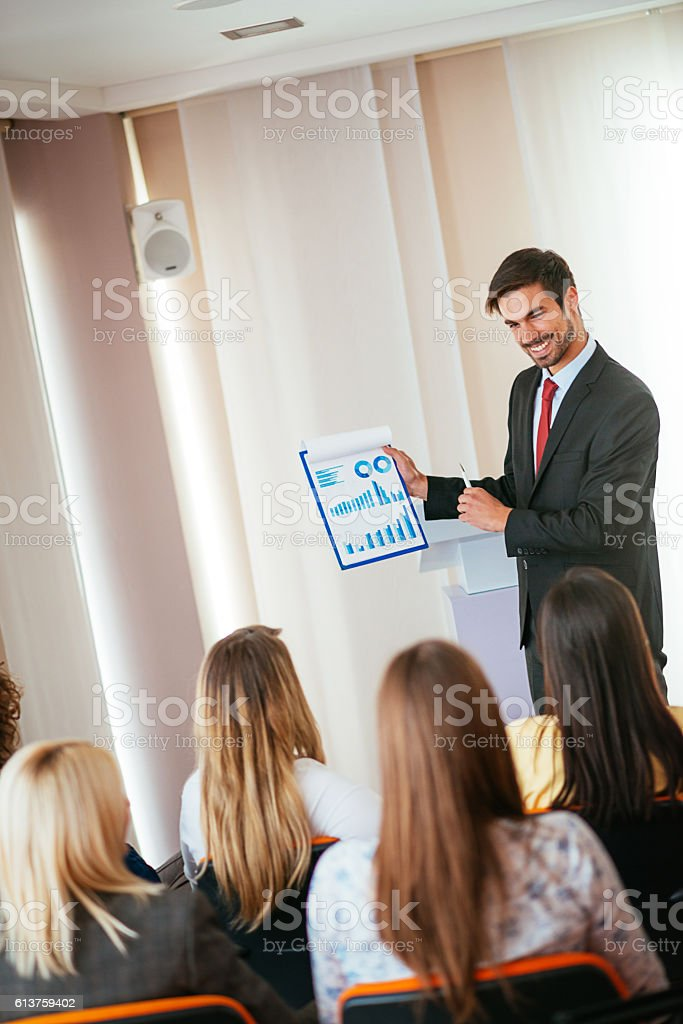 Marketing expert showing charts and graphs on financial market stock photo