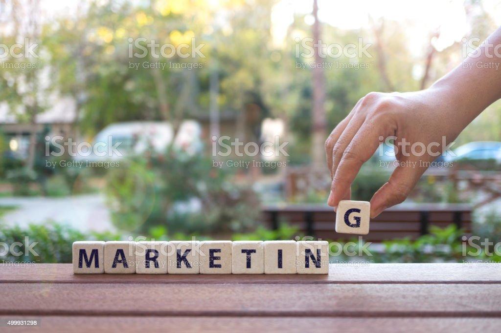 Marketing , Hand and Word with Alphabet Blocks stock photo