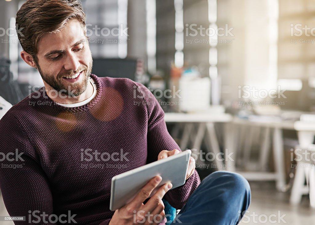 Marketing his business in a virtual world stock photo