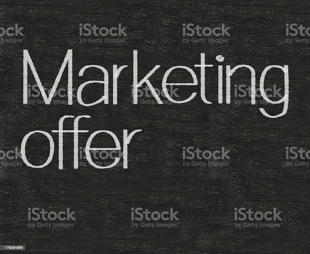 marketing offer written on blackboard background high resolution royalty-free stock photo