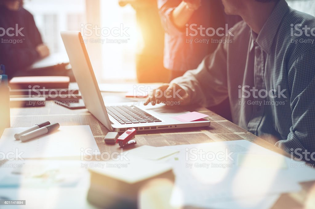 Marketing team discussing new working plan in office stock photo