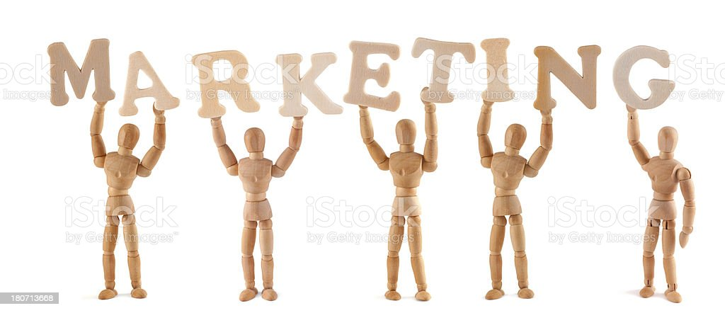 Marketing - wooden mannequin holding this word royalty-free stock photo