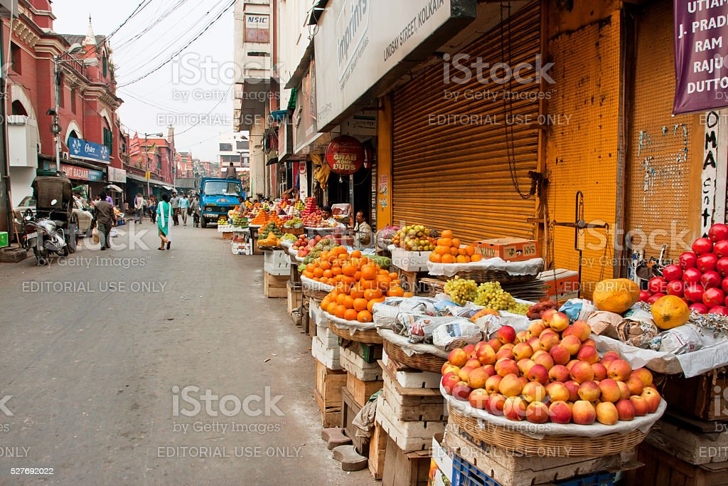 Marketplace with fresh fruits stall in a dirty street stock photo