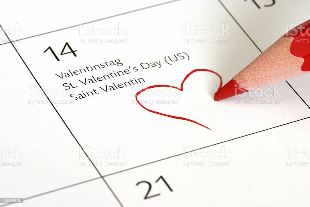Marking February 14th on the calendar with a heart royalty-free stock photo