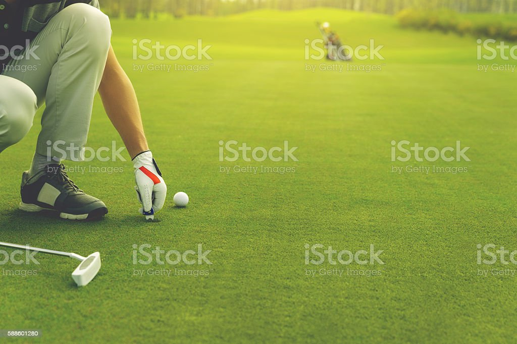 Marking golf ball position on the green stock photo