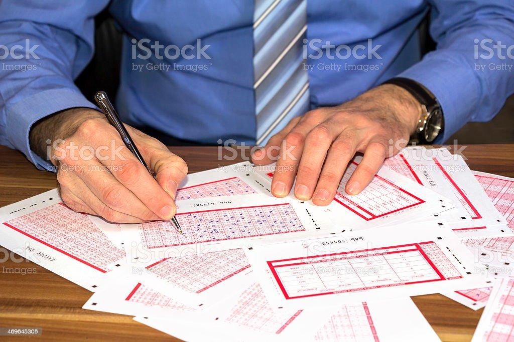 Marking lottery ticket stock photo