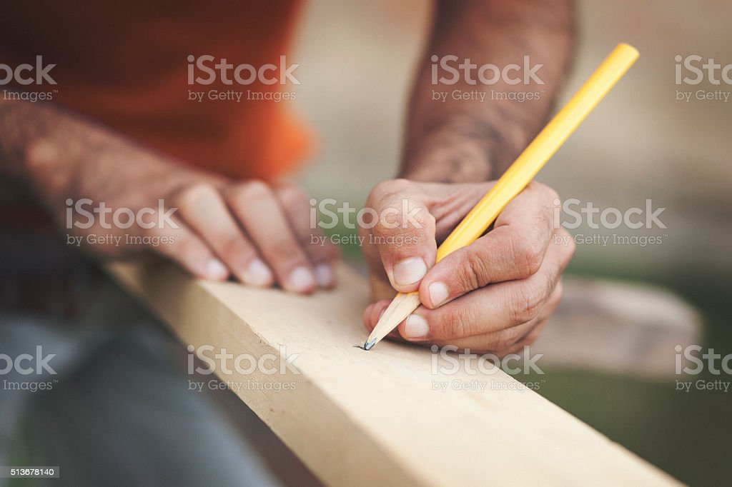 Marking the board for cutting stock photo