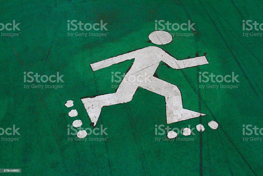 Markings of the roller on green asphalt stock photo