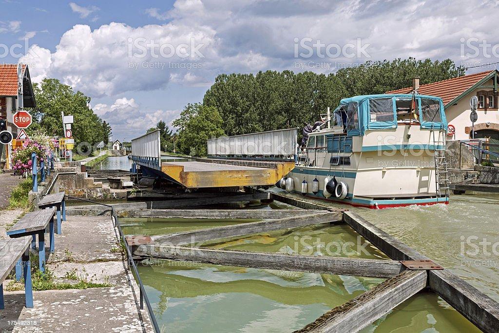 Marne-Rhine Canal: Boat passes swing bridge near Strasbourg stock photo