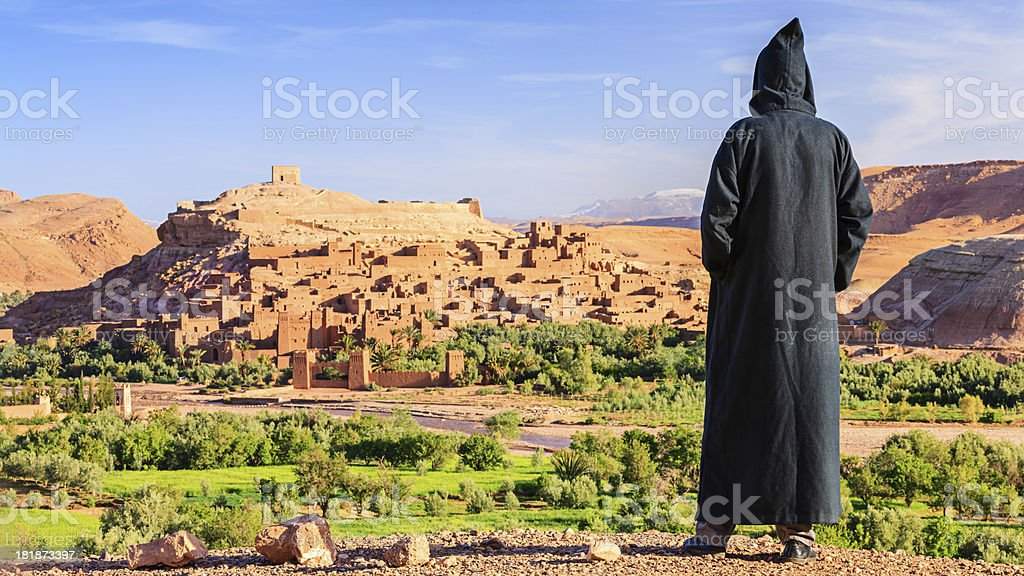 Maroccan man looking at Aït Benhaddou royalty-free stock photo
