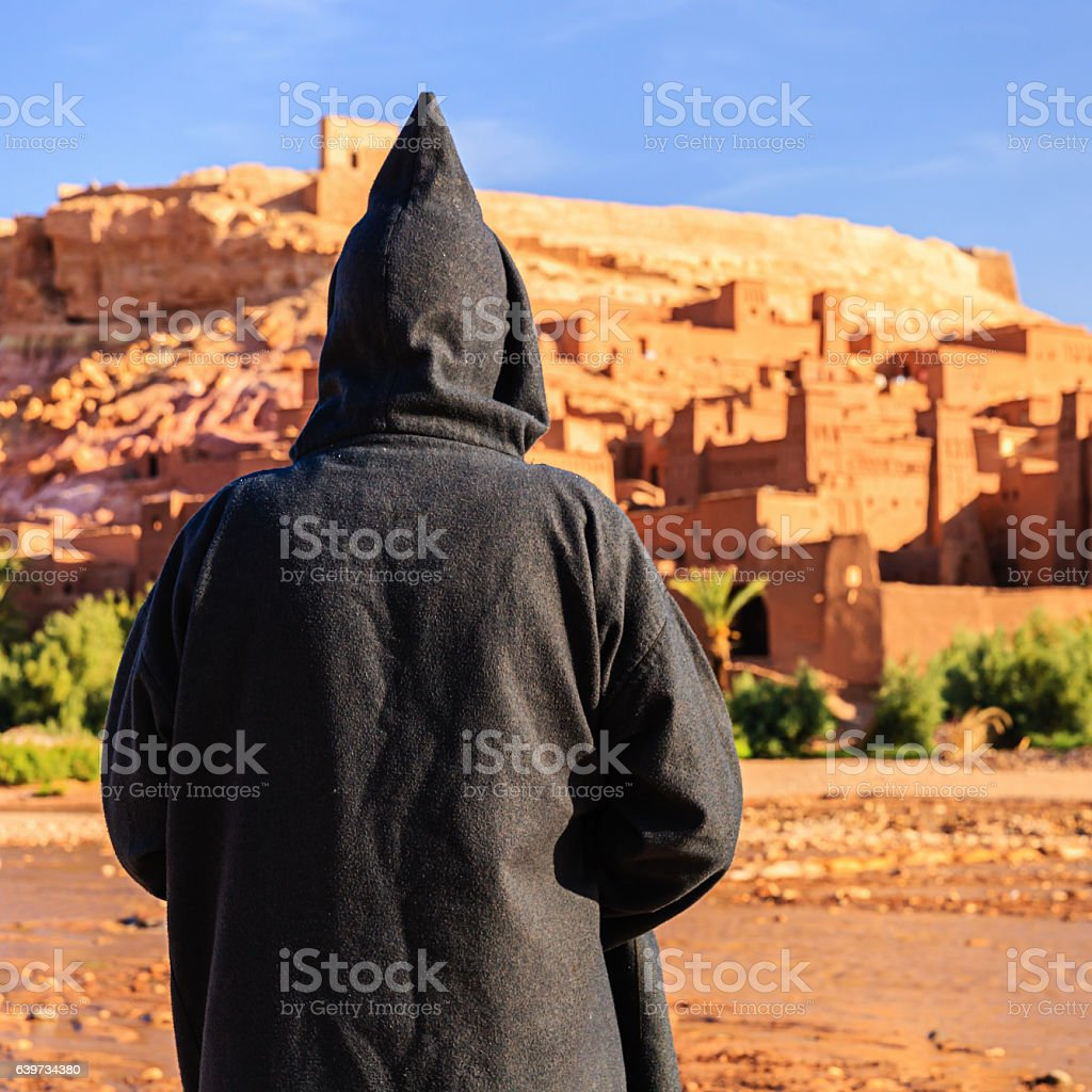 Maroccan man looking at Aït Benhaddou stock photo