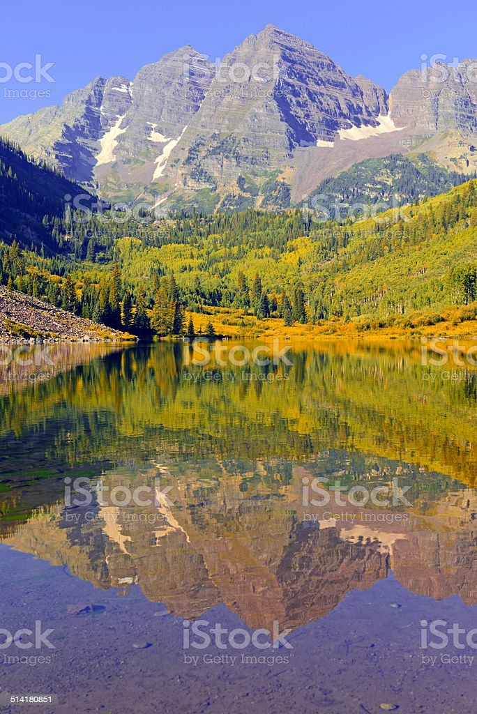 Maroon Bells reflecting in water, Elk Range, Rocky Mountains, Colorado stock photo