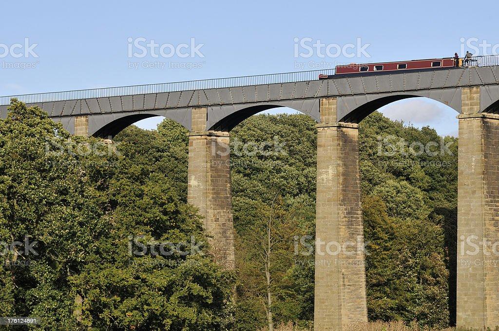 Maroon Boat  crosses Pontcysyllte Aqueduct stock photo