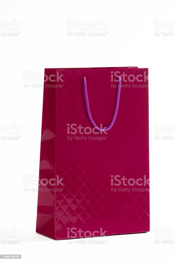 Maroon paper bag on a white background stock photo