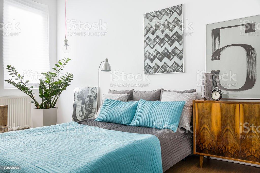 Marriage bed in cozy bedroom stock photo