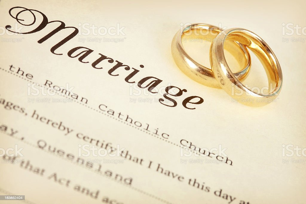 Marriage Certificate and Rings stock photo