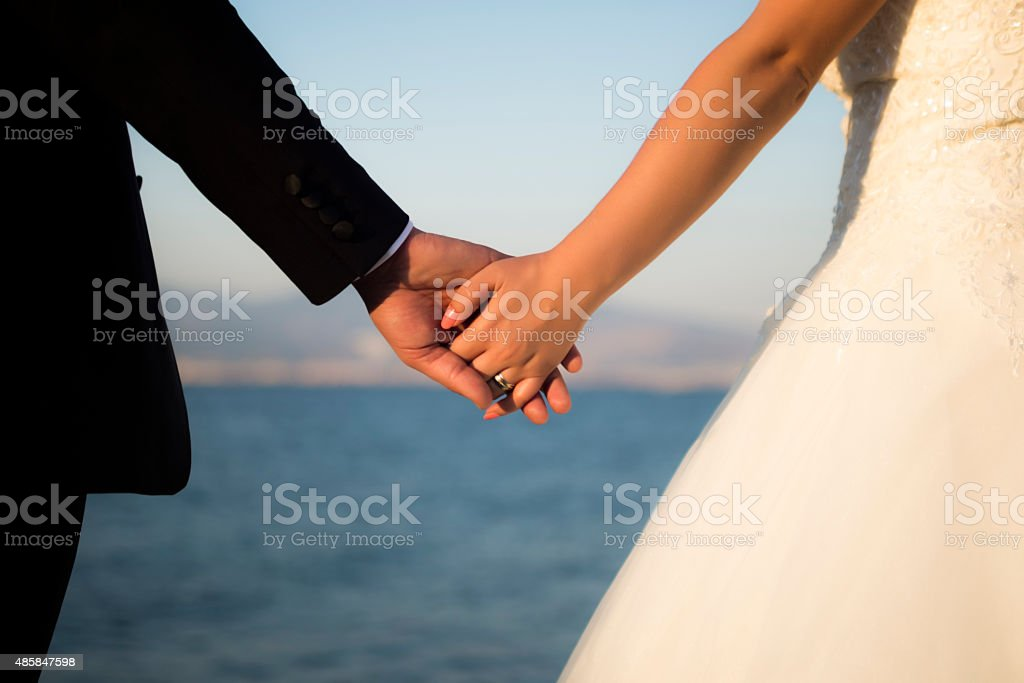 Marriage holding hands. stock photo