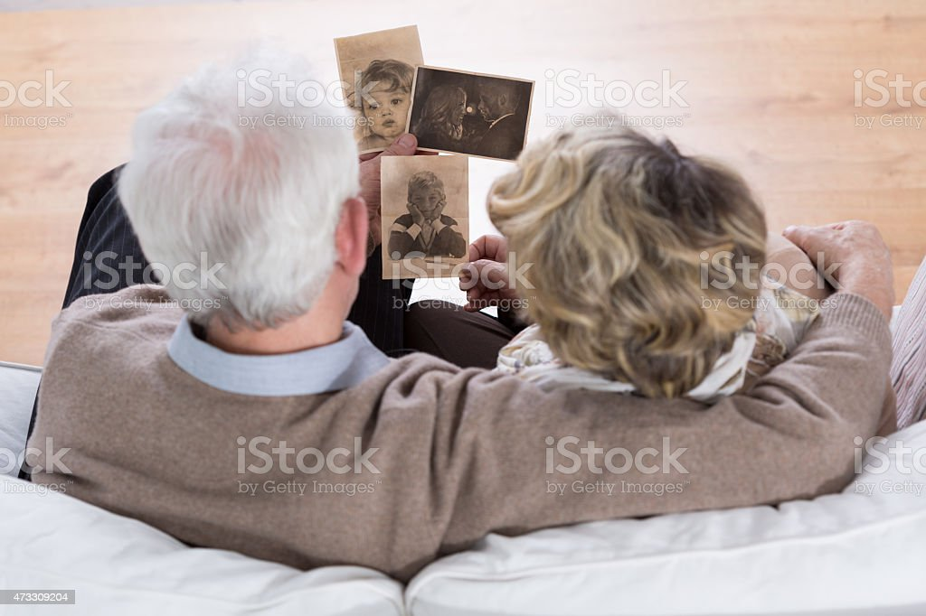 Marriage looking at photos stock photo
