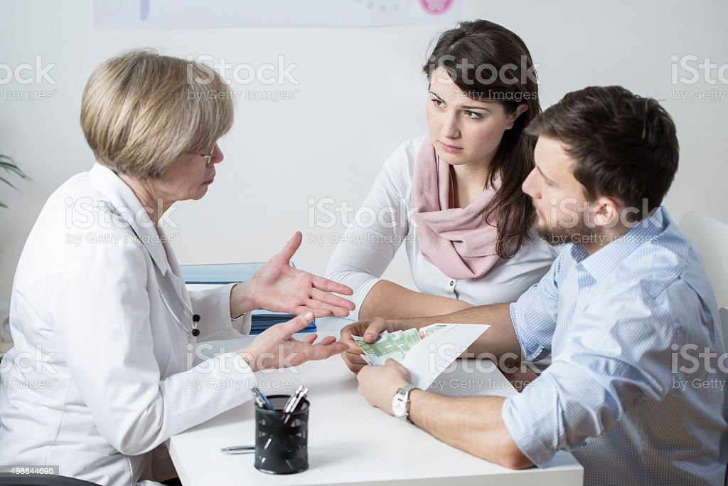 Marriage paying for IVF process stock photo