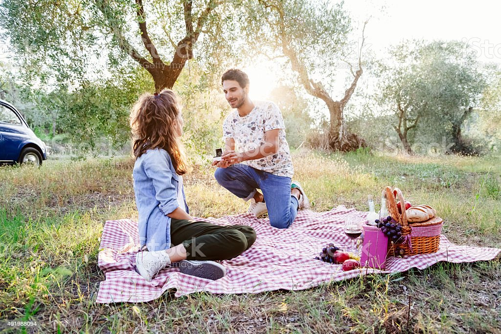 Marriage proposal at a picnic in the Tuscan countryside stock photo