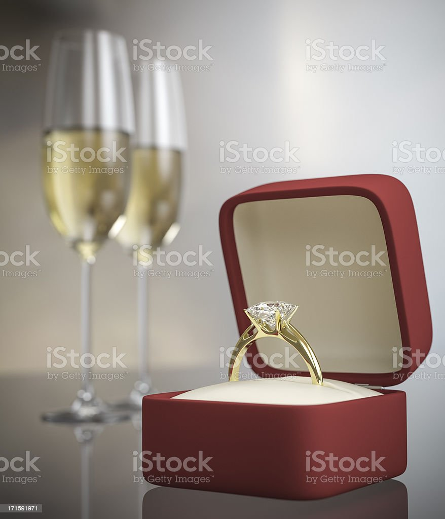 Marriage proposal concept with ring and two glasses of wine stock photo