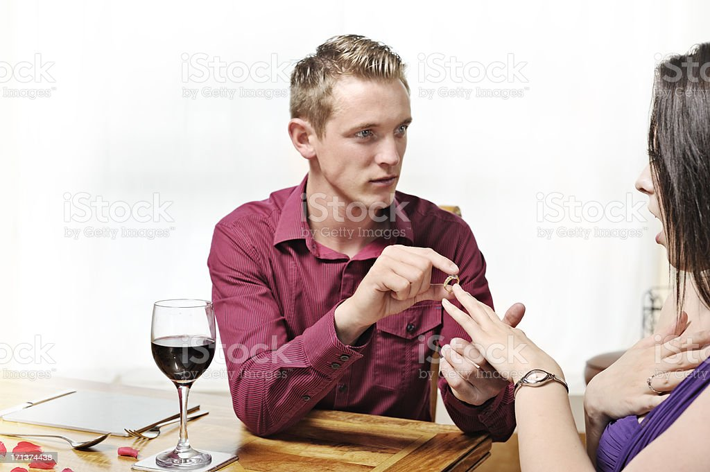 Marriage proposal in restaurant stock photo