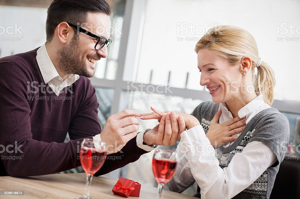 marriage proposal, man give ring to his girl stock photo