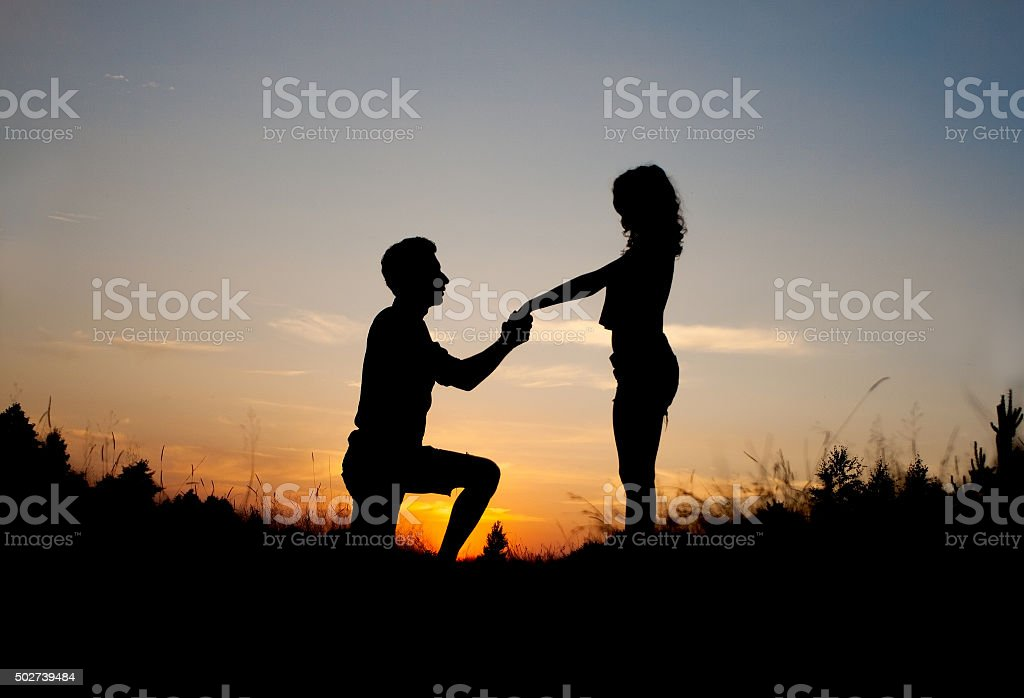 Marriage Proposal Sunset stock photo
