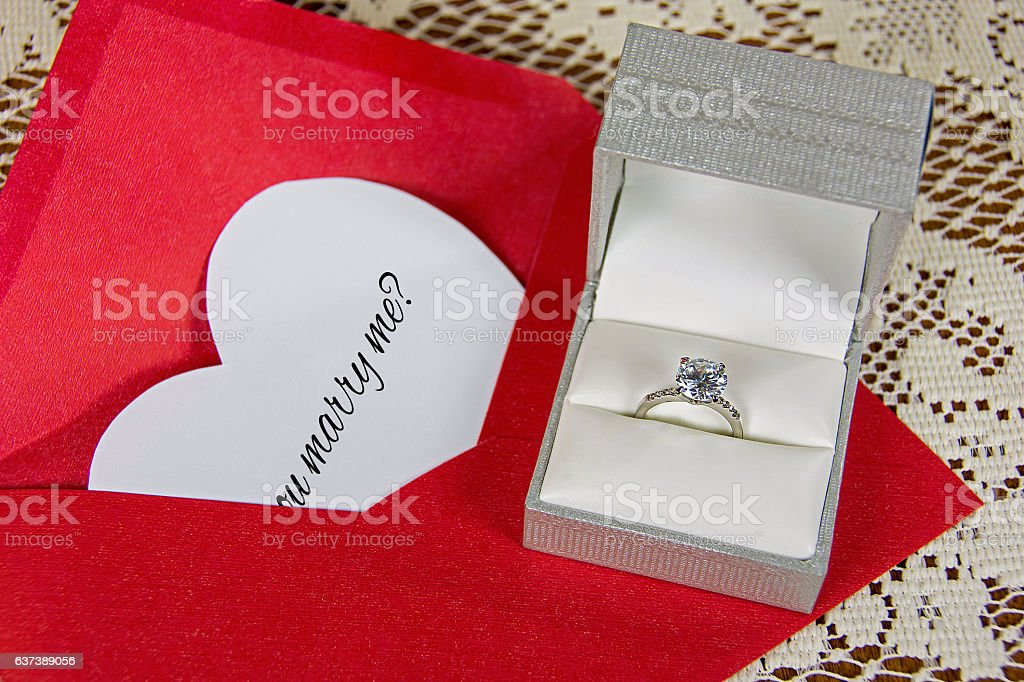 marriage proposal with diamond ring stock photo