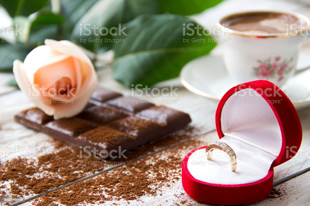 Marriage proposal with gold ring in the red hearth box stock photo