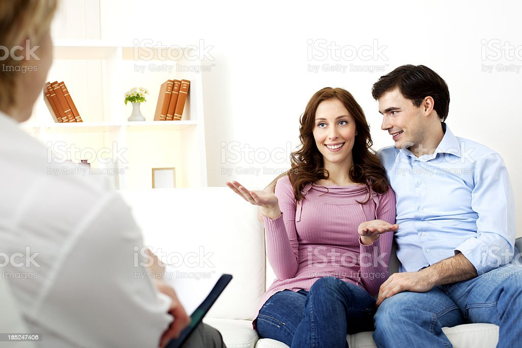 Marriage Therapy. Couple Talking to Counselor royalty-free stock photo