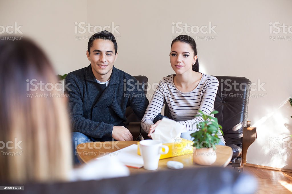 Marriage Therapy. Couple Talking to Counselor stock photo