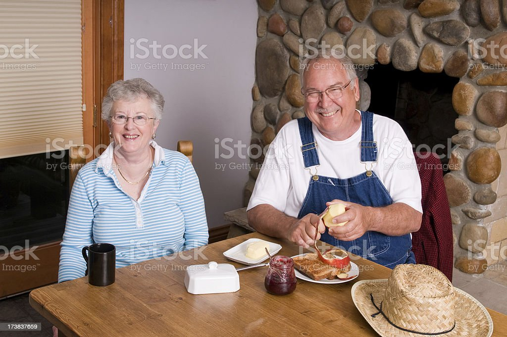 Married Couple Eating Breakfast royalty-free stock photo