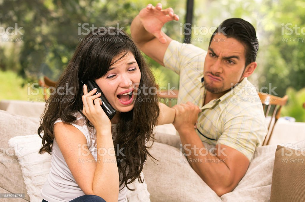 married couple fighting at home stock photo