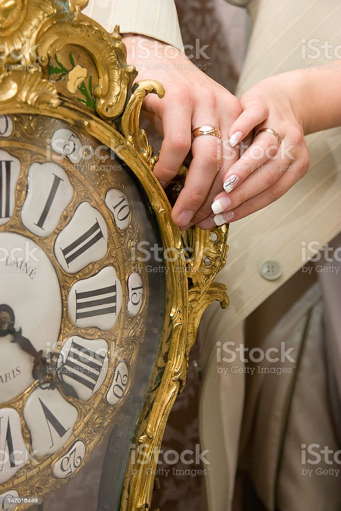 married couple hands on old clock royalty-free stock photo