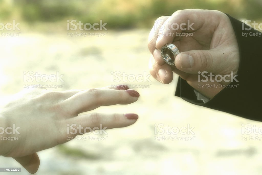 married couple holding hands with rings royalty-free stock photo