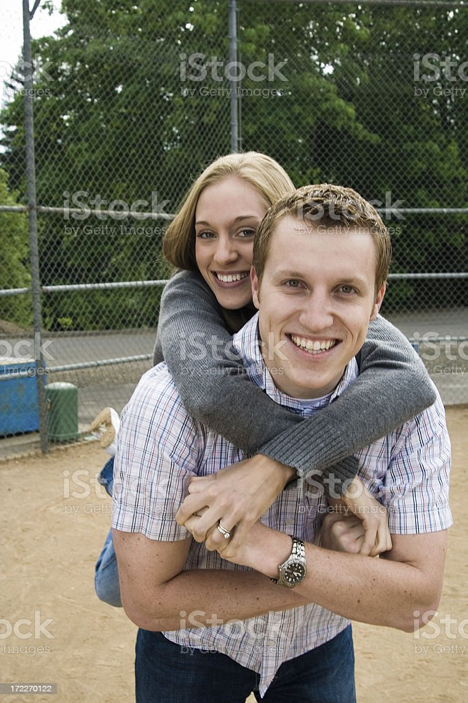 married couple in a baseball diamond royalty-free stock photo