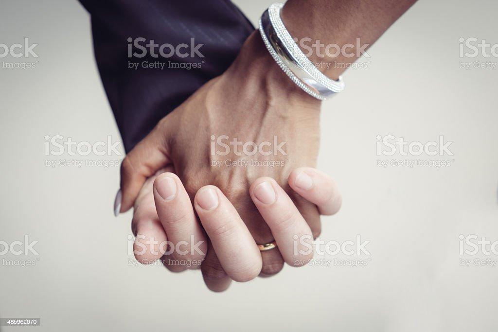 Married couple keep a hand stock photo