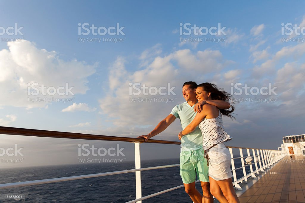 married couple standing on cruise deck stock photo