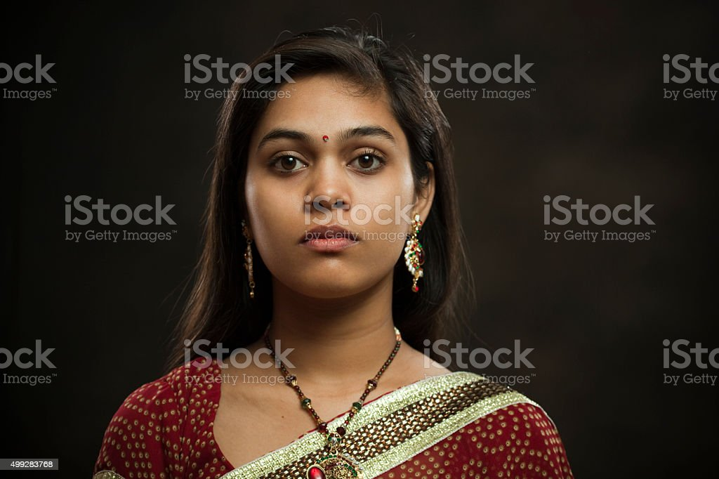 Married Hindu young woman looking at camera with blank expression. stock photo