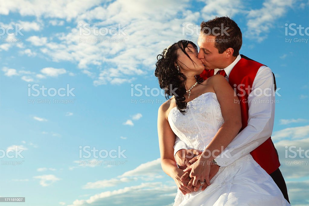 Married Kiss in the Sky stock photo