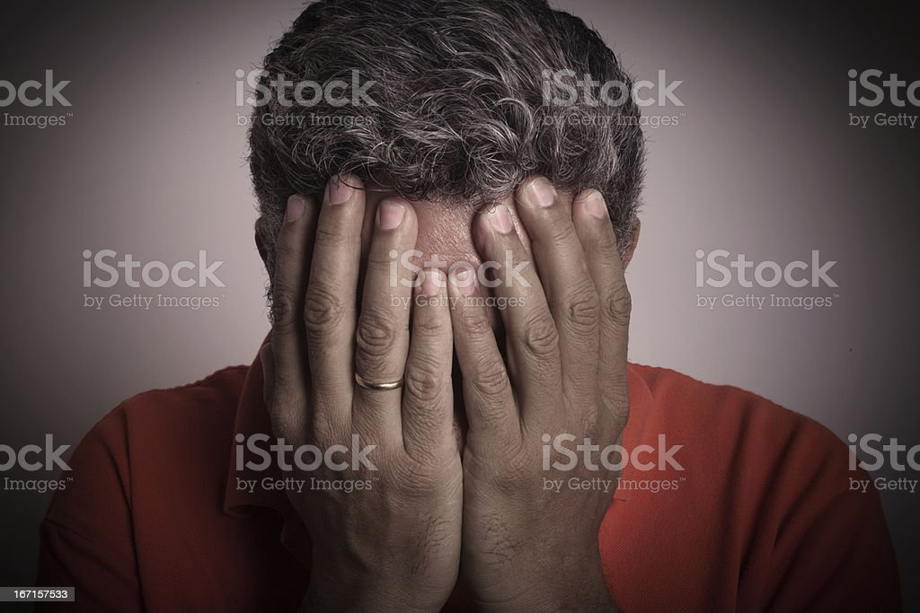 Married Man Fustrated and ashamed with hands on face royalty-free stock photo