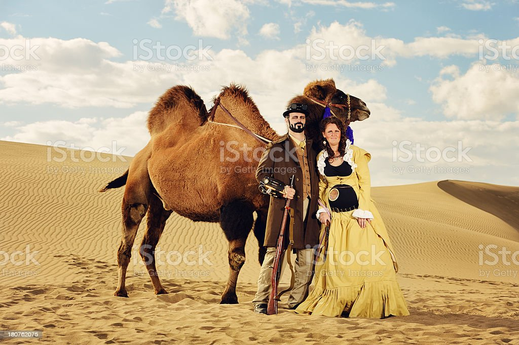 Married Steampunk Couple Traveling An Endless  Desert With Their stock photo