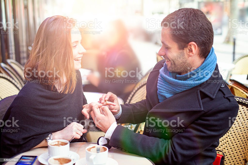 Marry me, man proposing marriage in a cafe Paris, France stock photo
