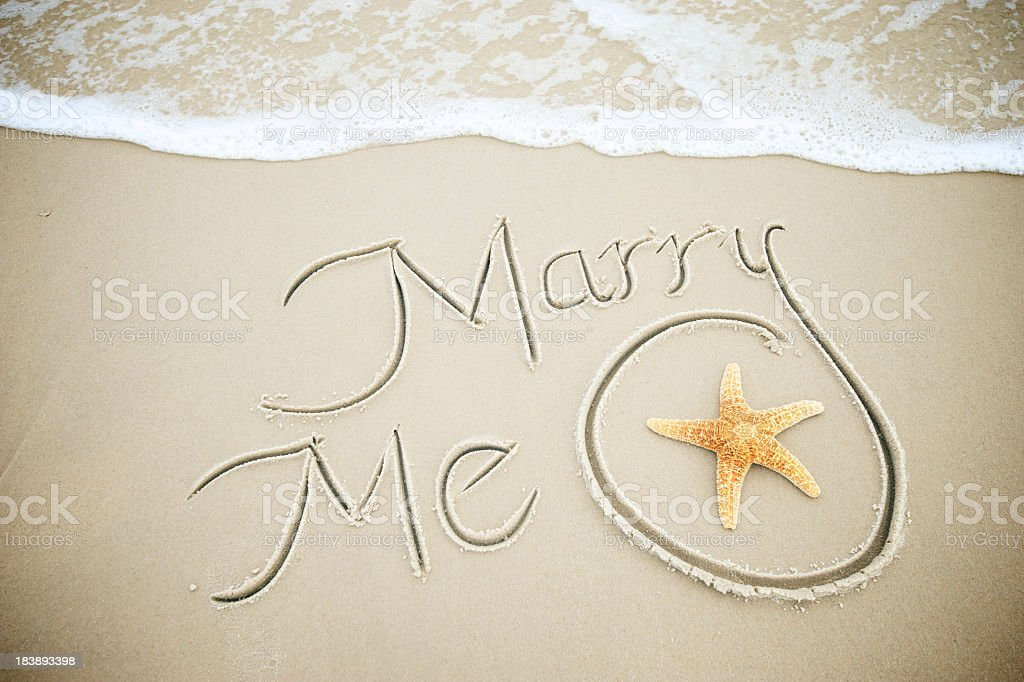 Marry Me Message Handwritten in Sand with Starfish royalty-free stock photo