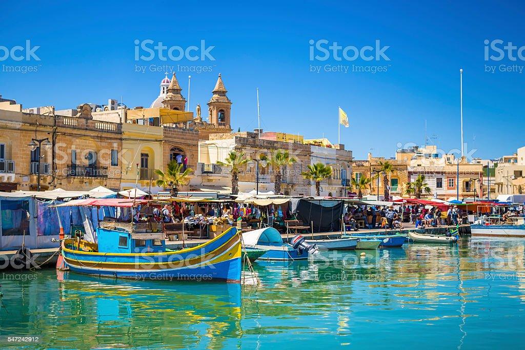 Marsaxlokk market with traditional Luzzu fishing boats stock photo