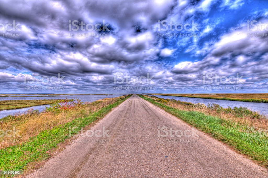 Marsh with Blue Sky and Clouds stock photo