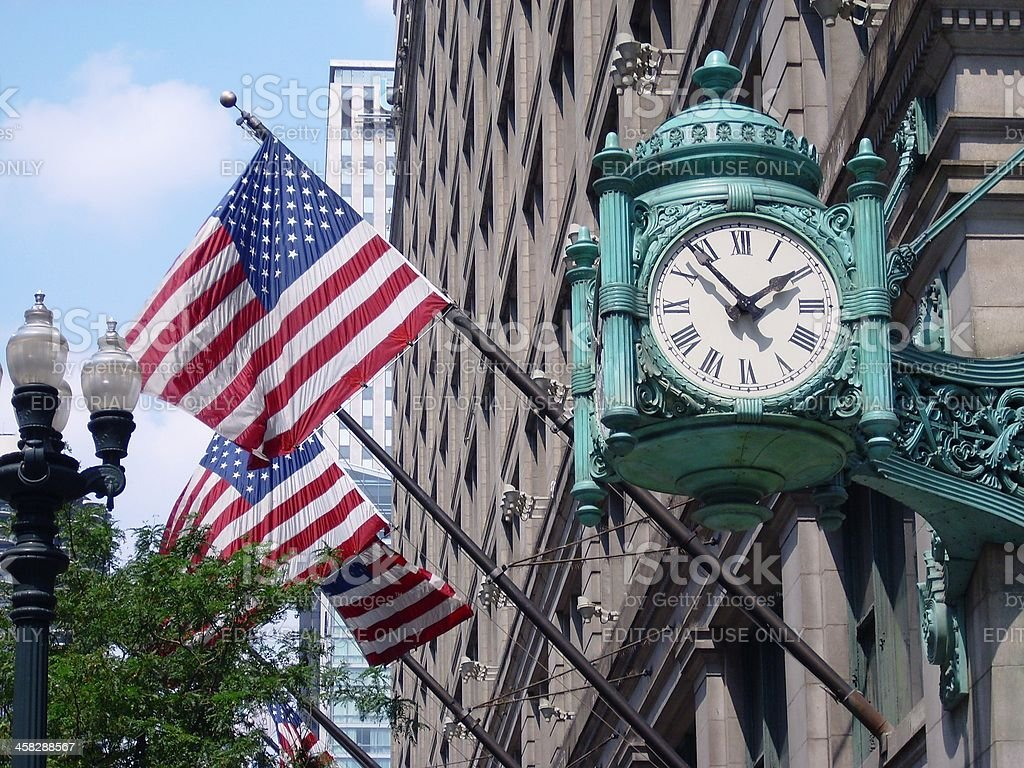 Marshall Field's clock and American Flags stock photo