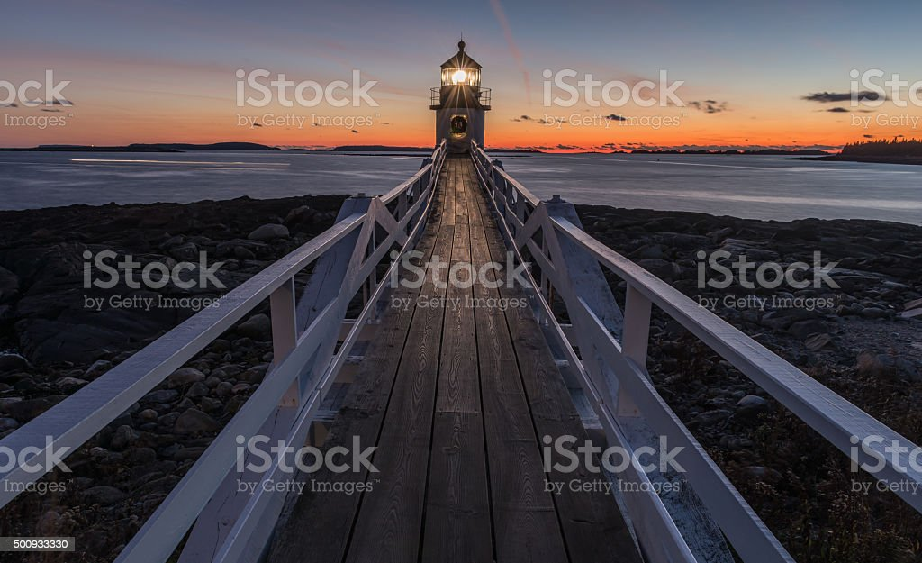 Marshall Point Lighthouse after sunset stock photo