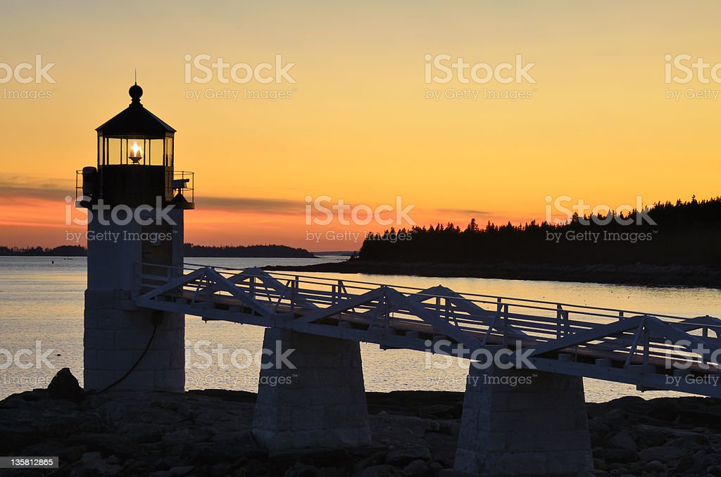 Marshall Point Lighthouse at Sunset stock photo